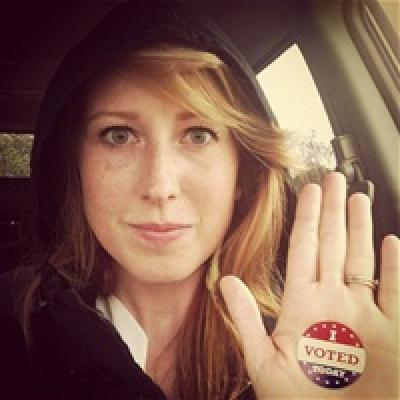 Woman holding up her hand with an I voted today sticker