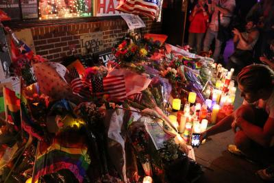 Flowers and candles near the Stonewall Inn