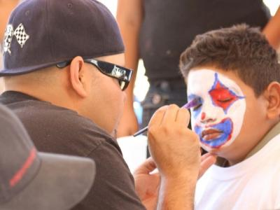 Close-up of a boy getting his face painted