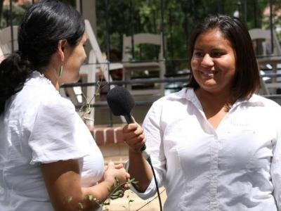 A woman getting interviewed