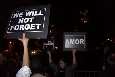 "Signs that say ""we will not forget"" and ""amor"""